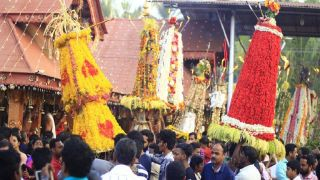 Procession of colourful Kalasham or Sacred urns decorated with flowers